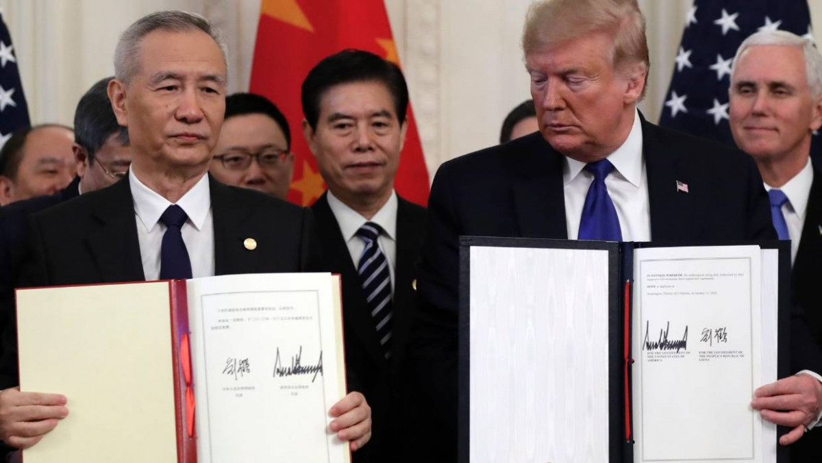 Initial US – China trade deal signed.
