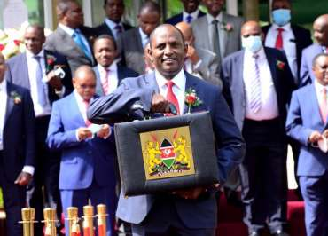 Image of Ukur Yatani holding the Kenya budget Outlook