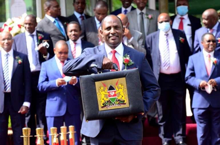 Image of Ukur Yatani holding the Kenya budget Outlook